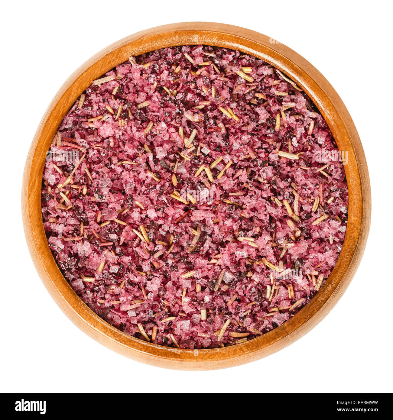 Fleur de Sel with dried hibiscus blossoms and rosemary in wooden bowl. Purple colored salt to flavor and garnish food. - Stock Image