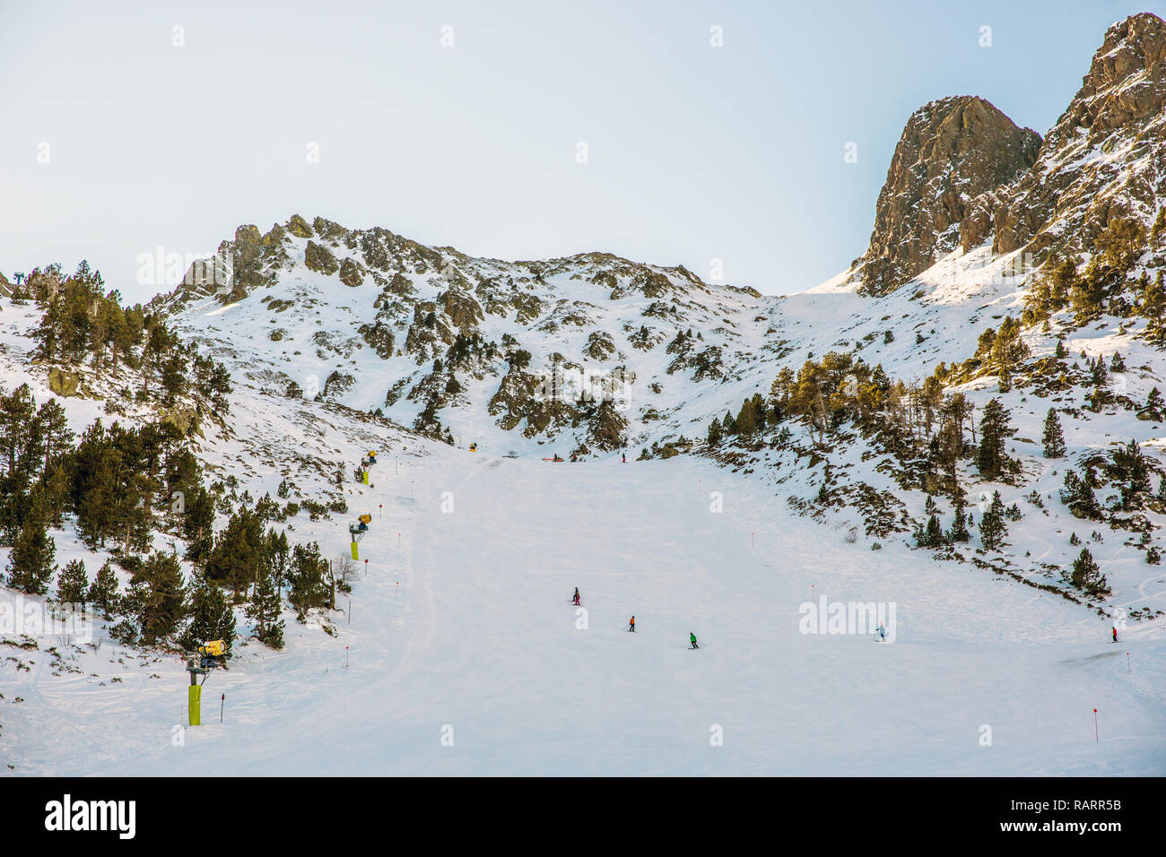 Tourists and locals running down in a snow slope in Andorra in Europe Stock Photo