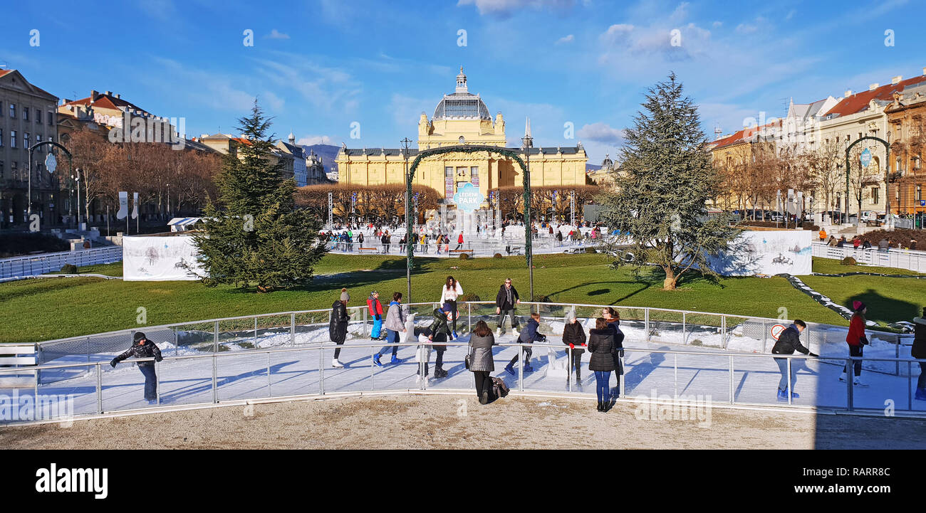 ZAGREB, CROATIA - JANUARY 04, 2019: Young people skating on the city ice skating rink on Advent time in King Tomislav Park on January 04, 2019 in Zagr - Stock Image