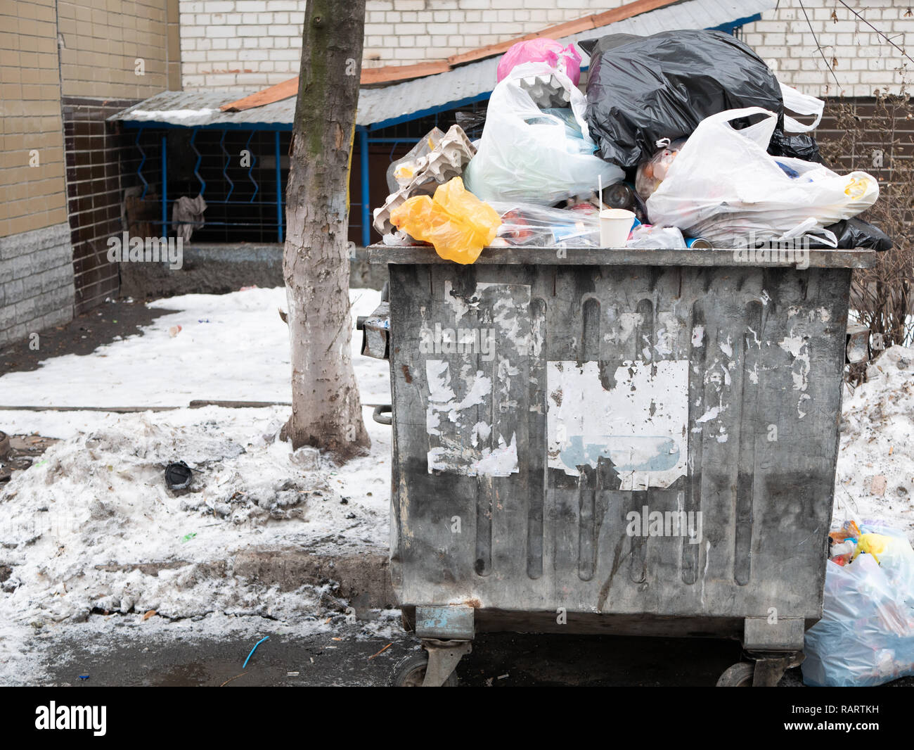big waste city container full of garbage. pile of trash. bad utilities work concept - Stock Image