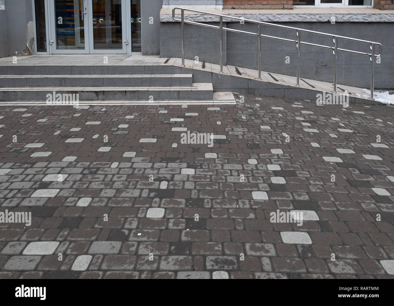 entrance to city store with special ramp for support disabled people using wheelchair - Stock Image