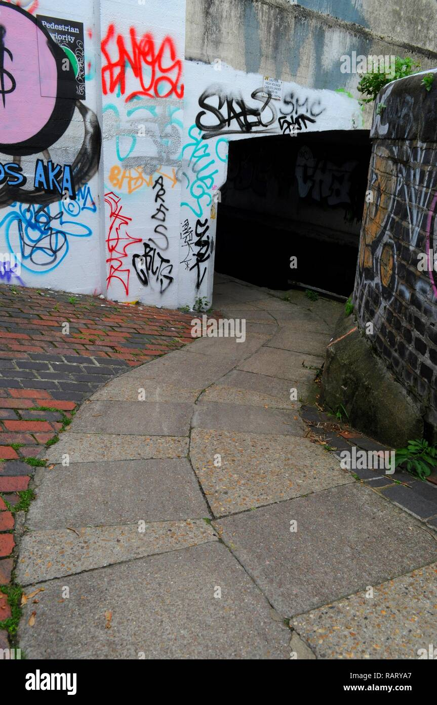 Hertford Union Canal towpath under Wick Lane Bridge over the Hertford Union Canal, East London, UK. - Stock Image