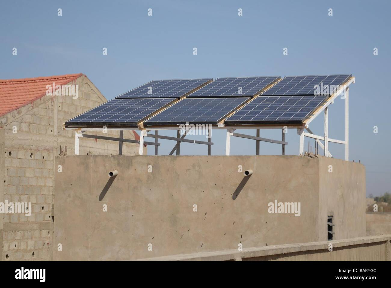 Completed solar panels on a building in the rural city of Mbour in the Republic of Senegal in West Africa. - Stock Image