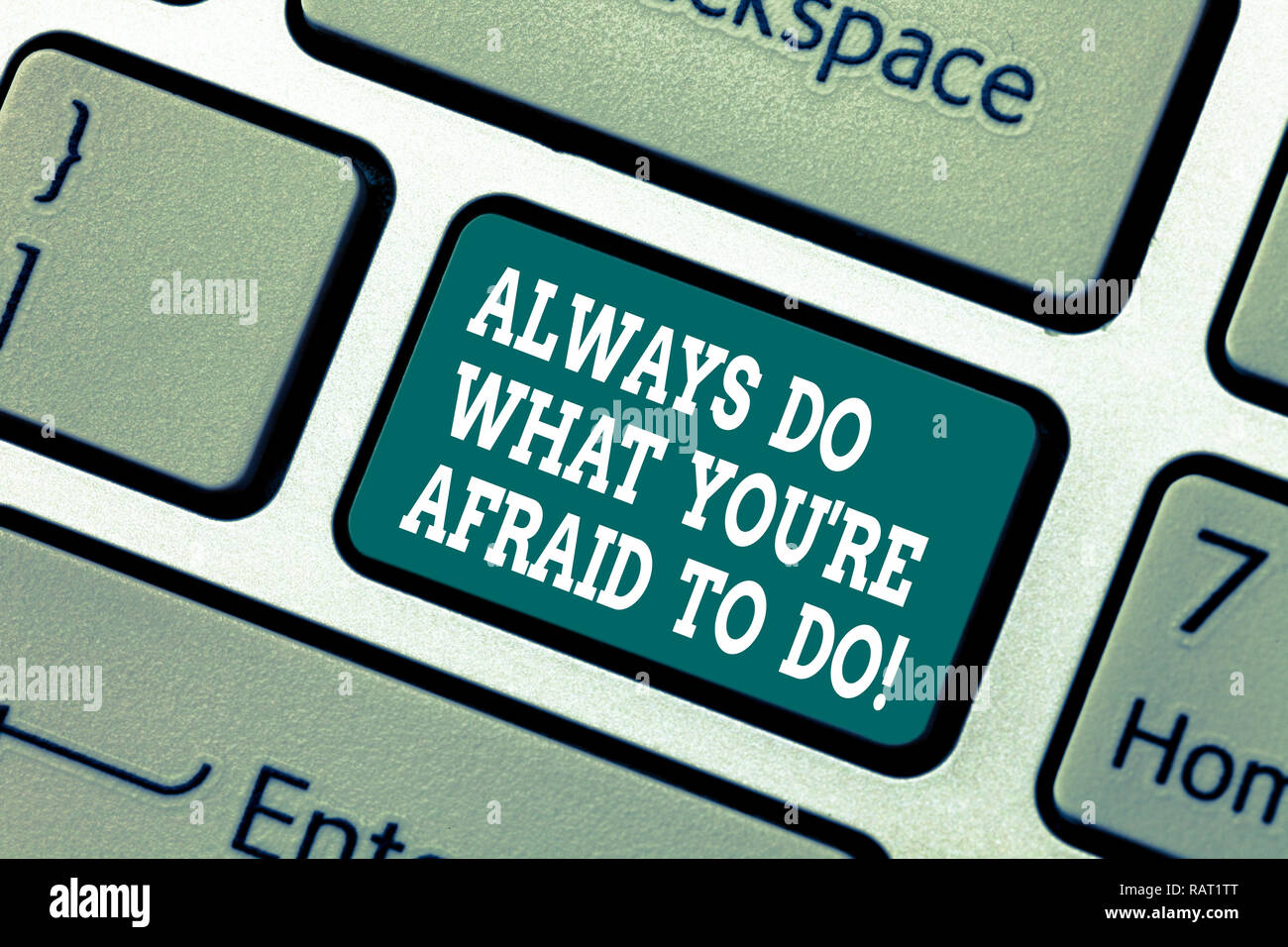 Writing note showing Always Do What You Re Afraid To Do. Business photo showcasing Overcome your fear Challenge motivation Keyboard key Intention to c - Stock Image