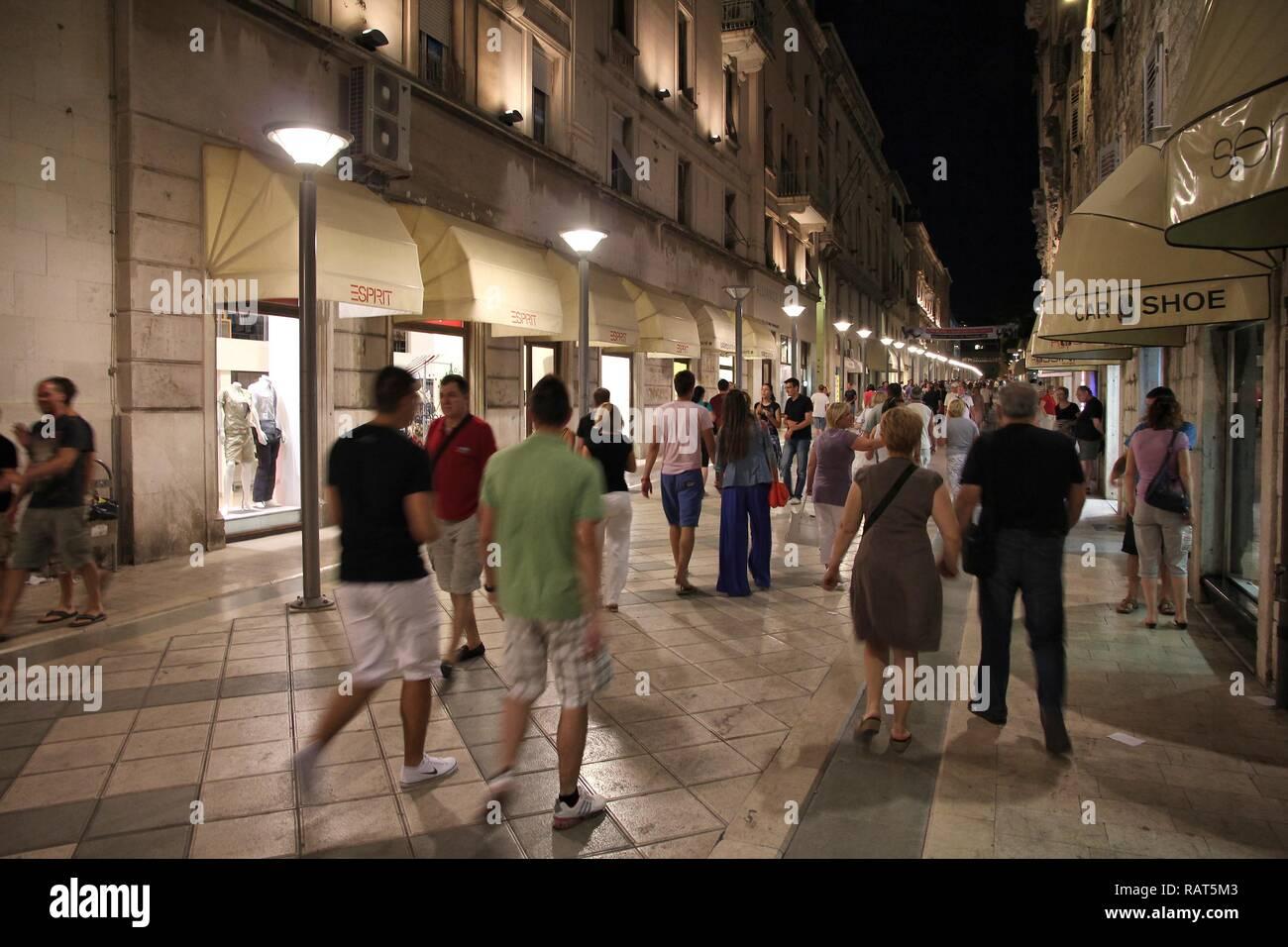 SPLIT, CROATIA - JUNE 27: People walk the old town street in the night on June 27, 2011 in Split, Croatia. In 2011 11.2 million tourists visited Croat - Stock Image