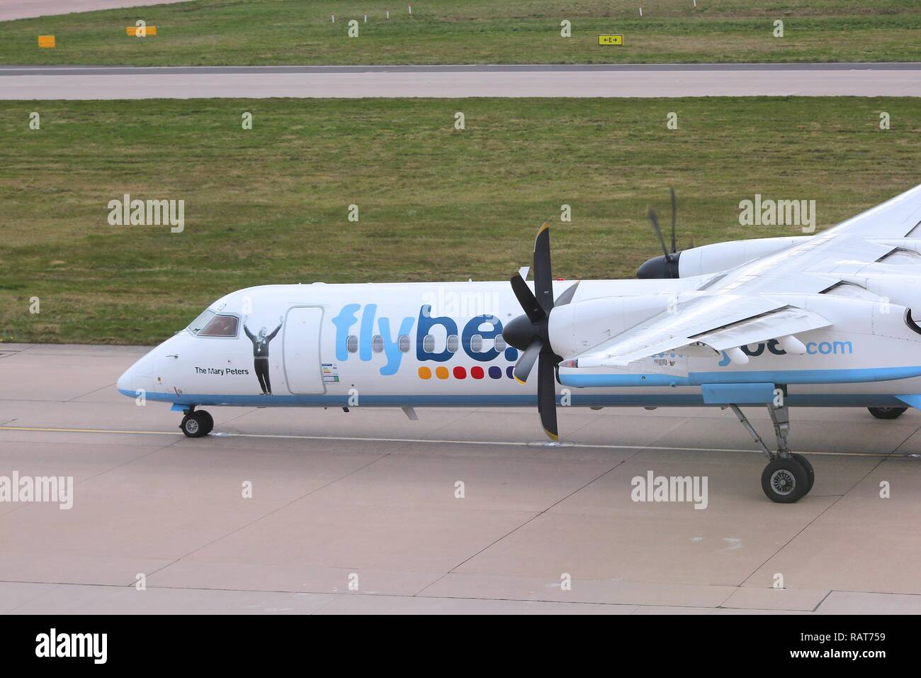 BIRMINGHAM, UK - APRIL 24, 2013: Pilots taxi Flybe Bombardier Dash 8 Q-400 at Birmingham Airport, UK. Flybe carried 7.6 million passengers in 2013. - Stock Image