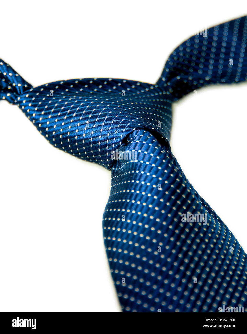 Classic Blue Micro Dot Patterned Necktie with Windsor Knot - Stock Image