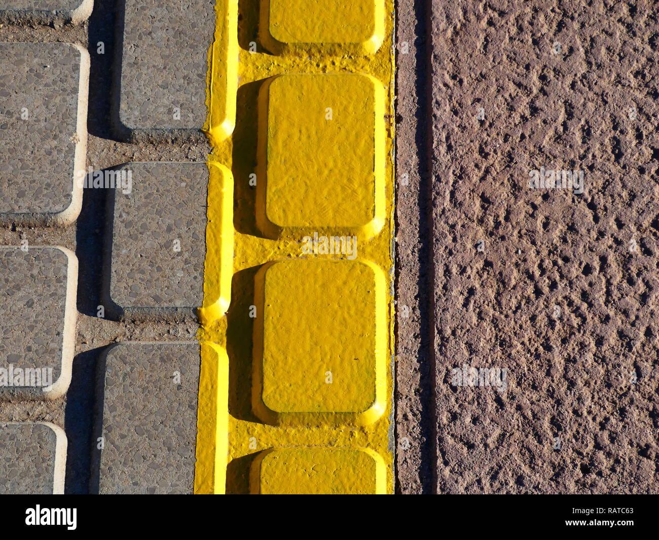 Yellow markings on the floor - Stock Image