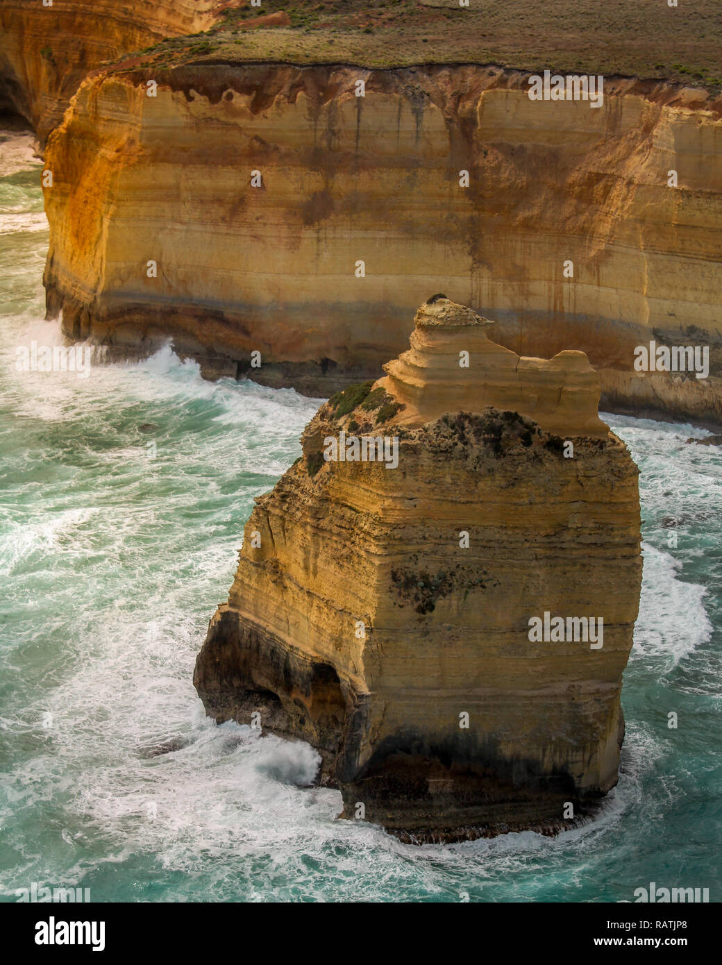 Aerial view onto one of the Twelve Apostles at the Great Ocean Road captured inside of a helicopter at sunset / dawn (Great Ocean Road, Australia) - Stock Image
