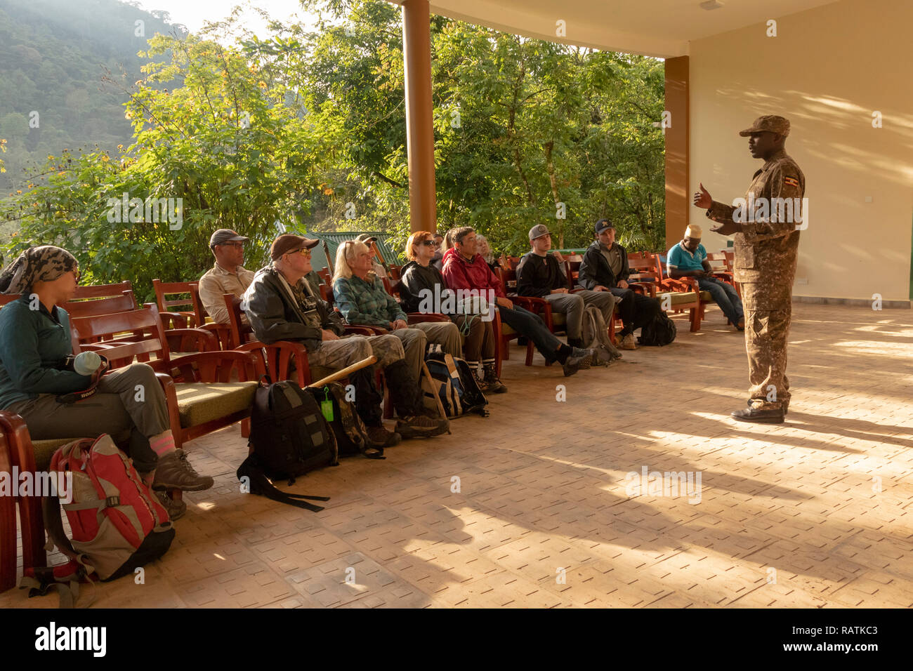 Park ranger explaining rules for gorilla trekking to tourists on safari, Bwindi Impenetrable Forest National Park, Bwindi, Uganda, Africa - Stock Image