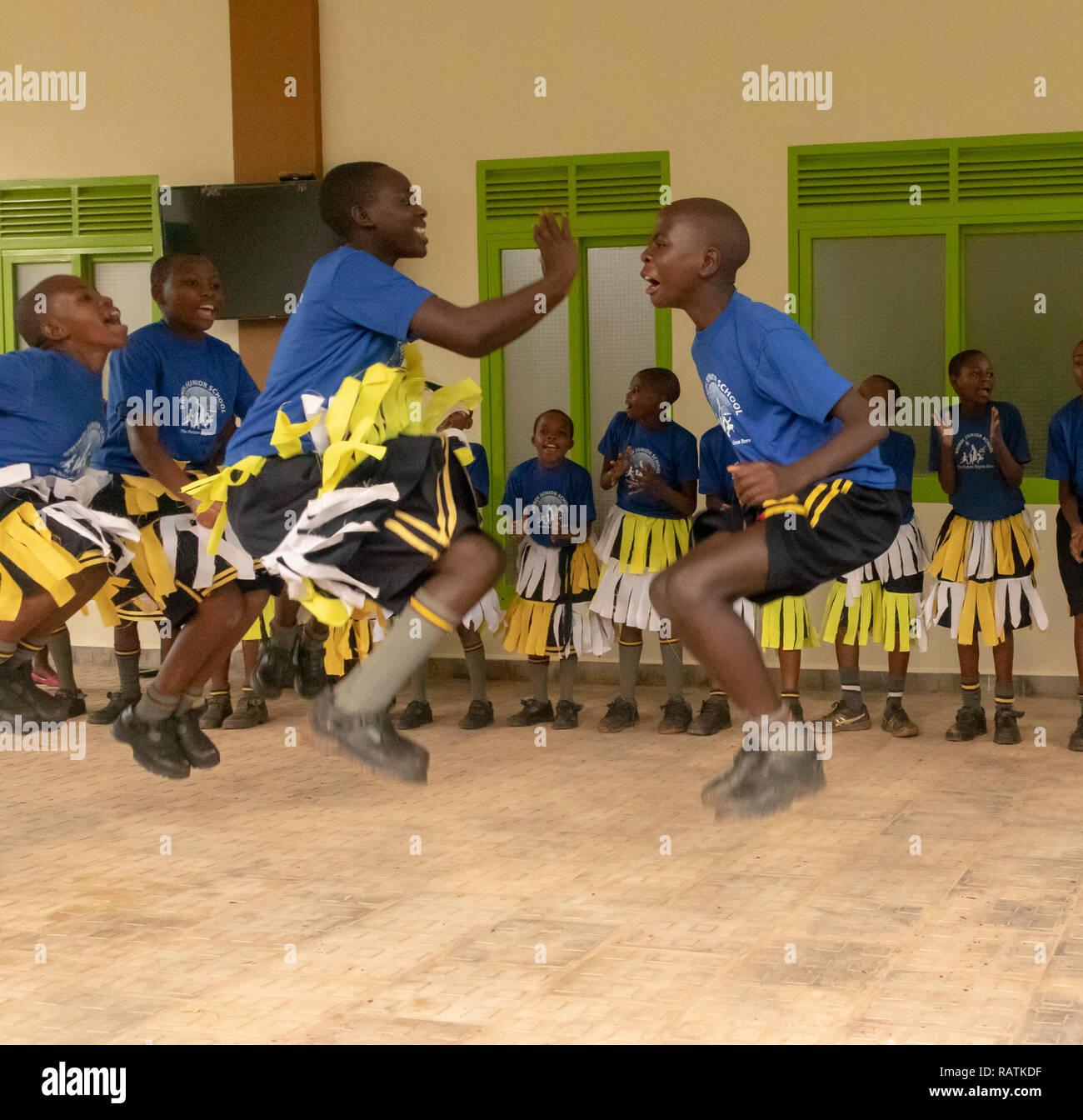 Schoolchildren From Bwindi Junior School Performing A Dance For Tourists Before Gorilla Trekking Safari Bwindi Impenetrable National Park Uganda Stock Photo Alamy
