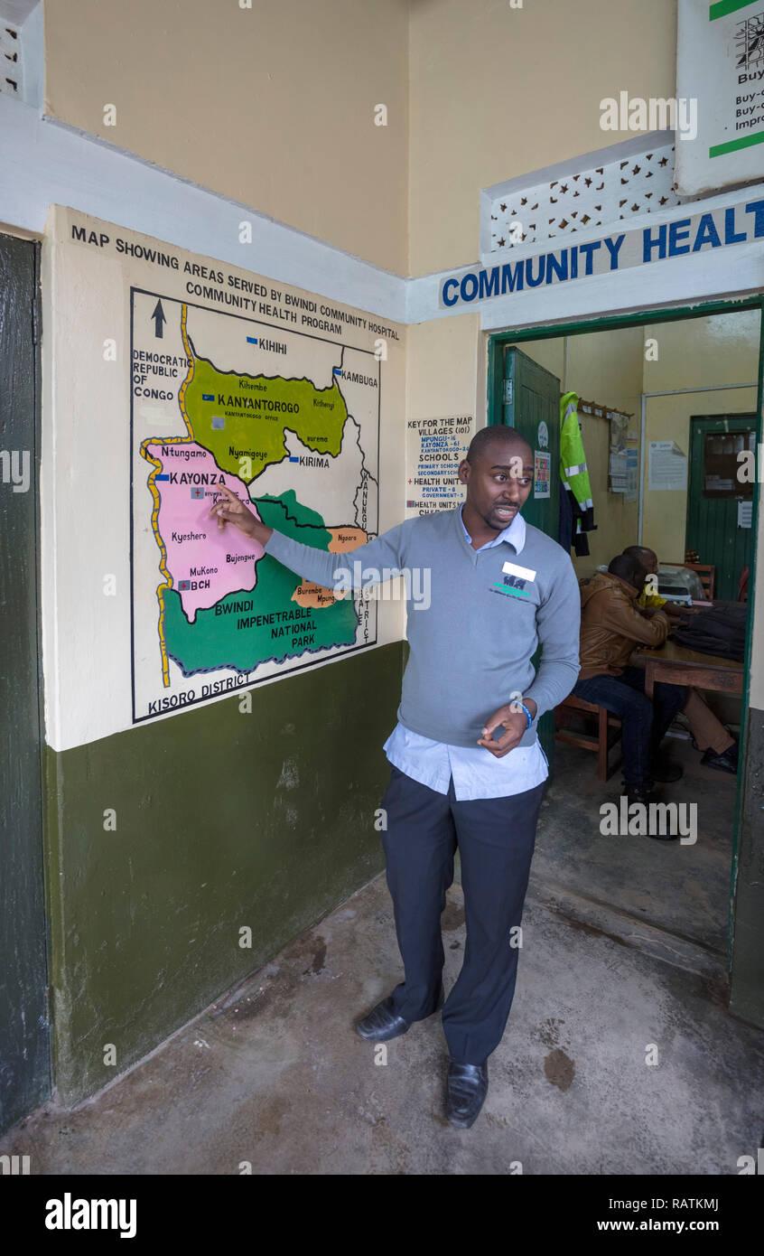 guide explaining areas served by Bwindi Community Hospital, Uganda, Africa - Stock Image