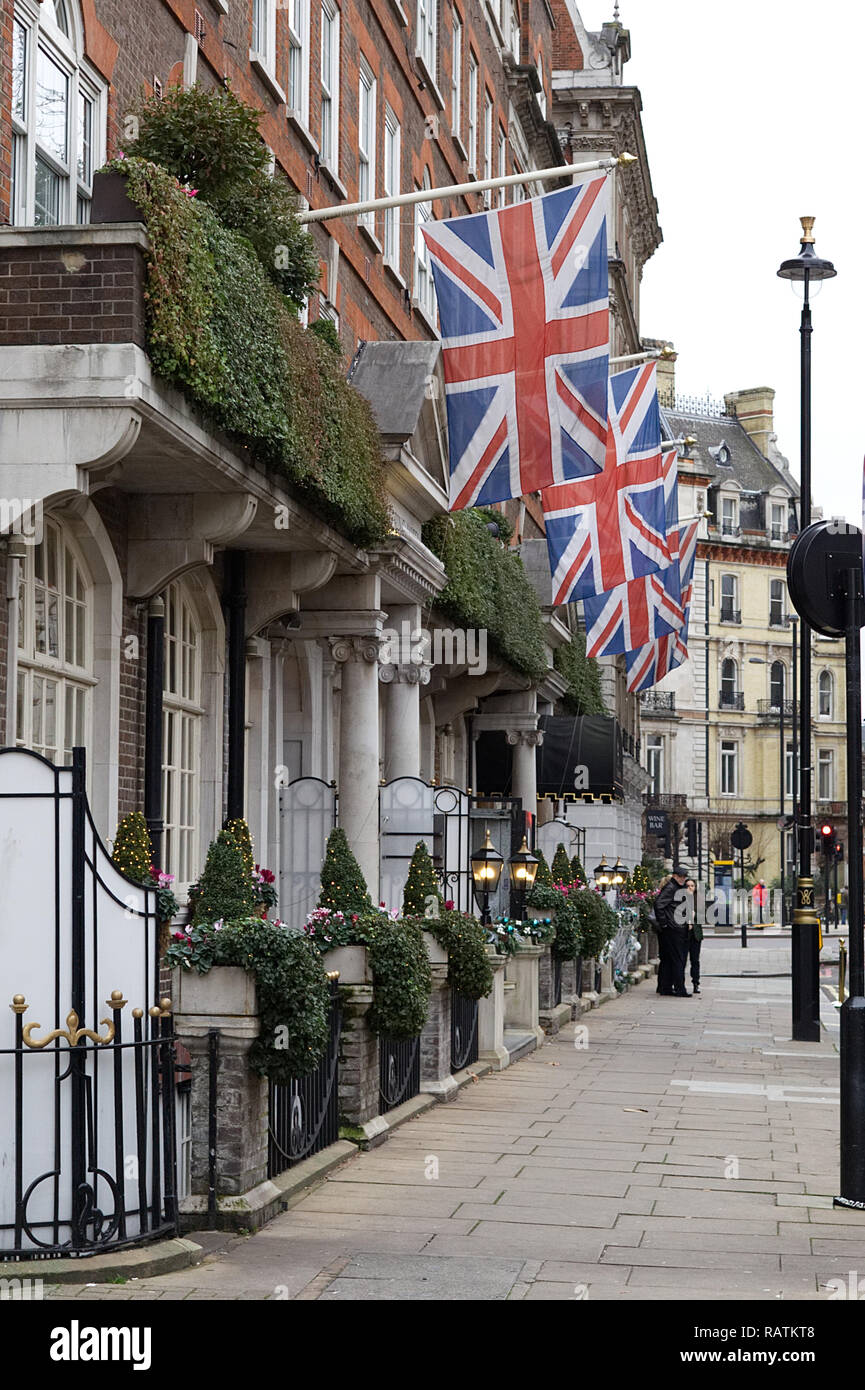 Union Jacks flying at a hotel in Victoria Square London - Stock Image