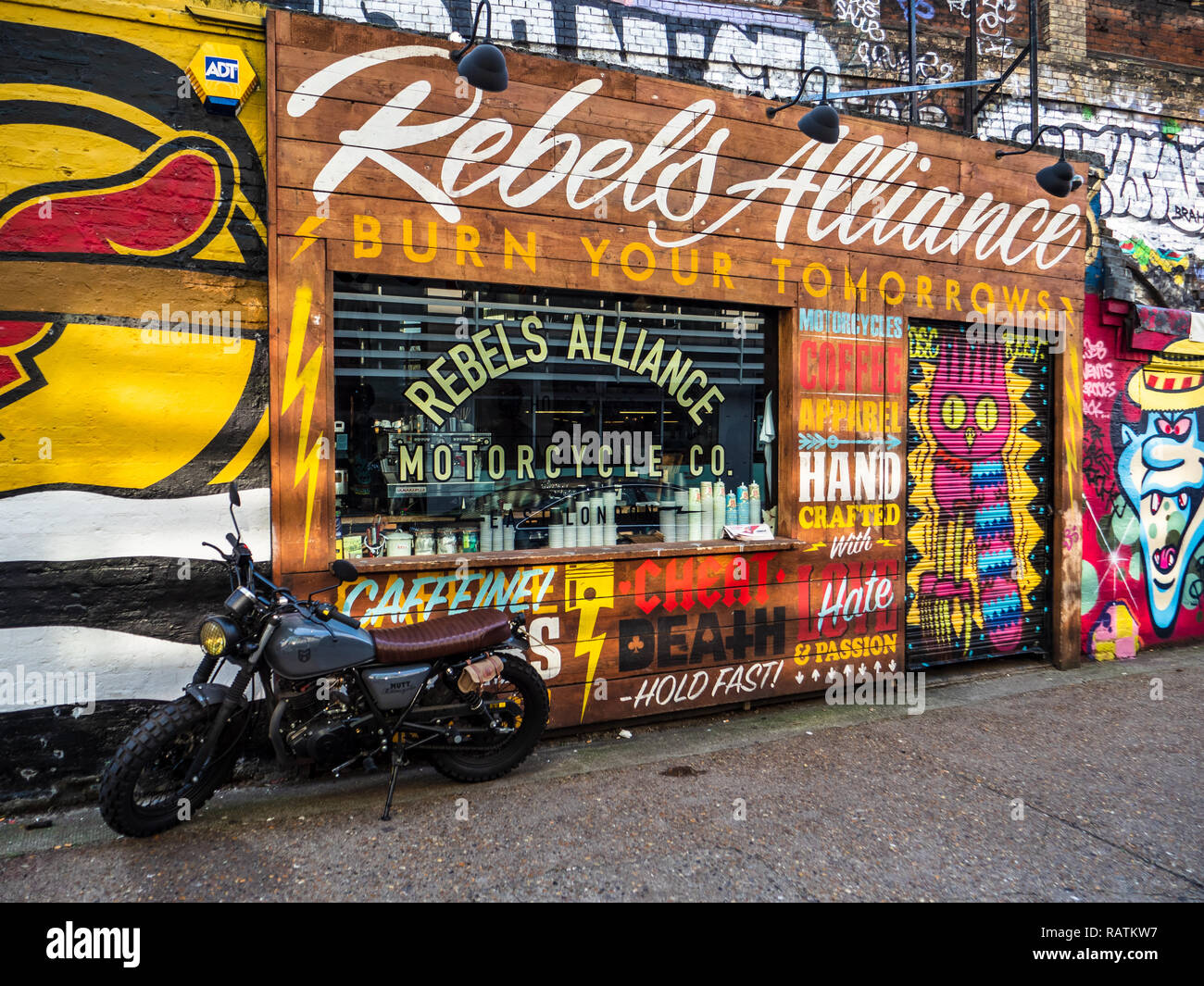 Rebels Alliance Motorcycles, clothes and Coffee Shop in hip Shoreditch East London near Brick Lane. Custom Made motorcycles. - Stock Image