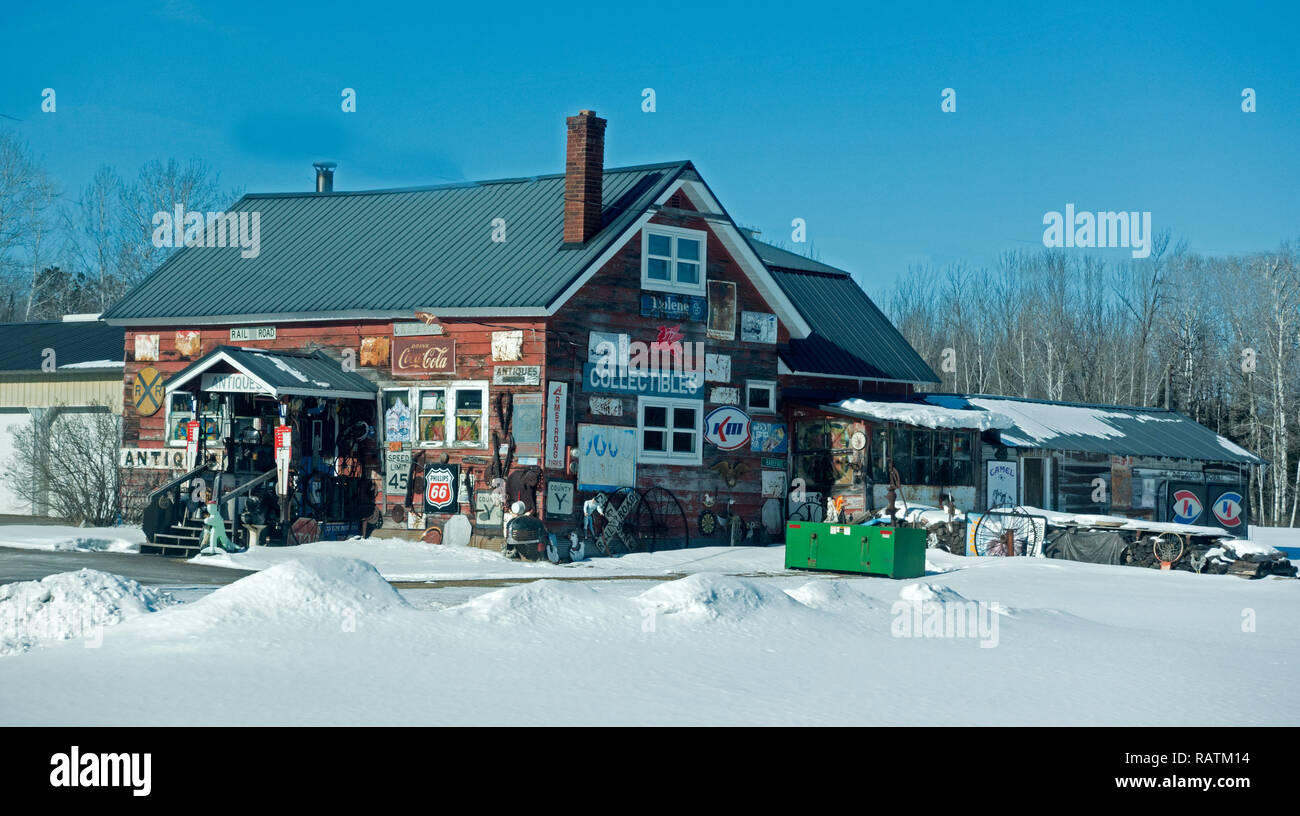 Rustic antique shop with outside covered with collectible signs. Highway 2 Wisconsin WI USA - Stock Image