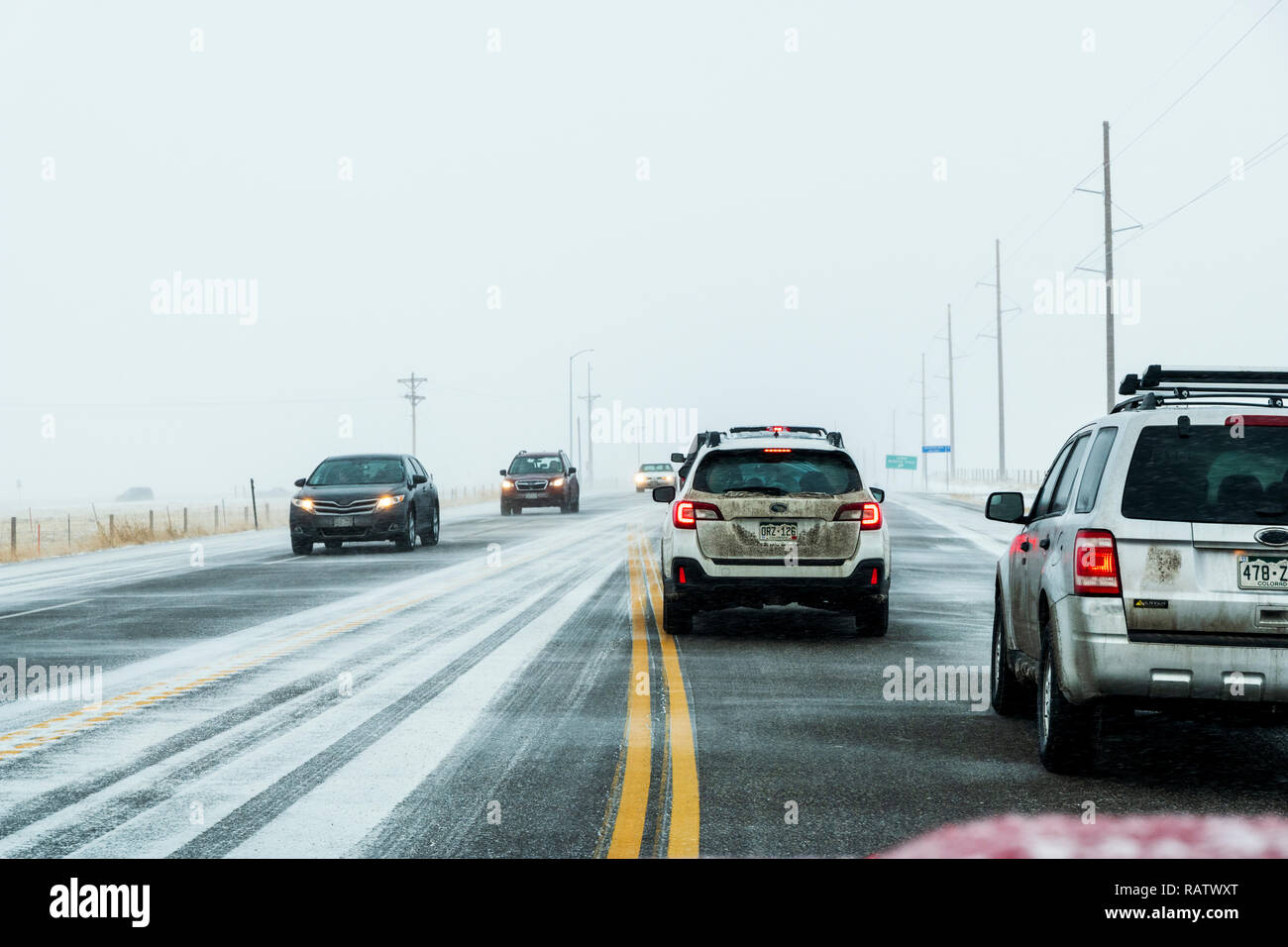 Traffic slowed due to winter storm; Rt. 285; near Jefferson; central Colorado; USA - Stock Image