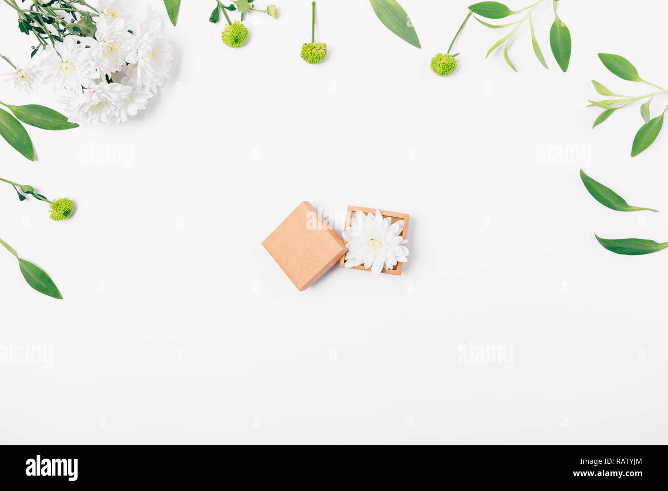 Flat Lay Floral Arrangement Of Open Small Gift Box Of Brown Eco