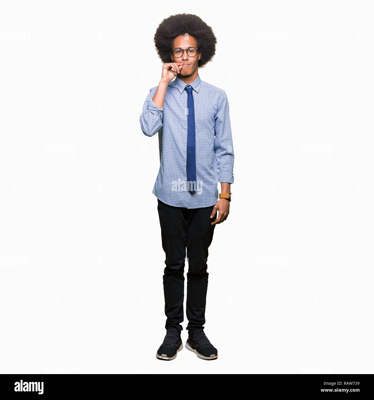 Young african american business man with afro hair wearing glasses mouth and lips shut as zip with fingers. Secret and silent, taboo talking - Stock Image