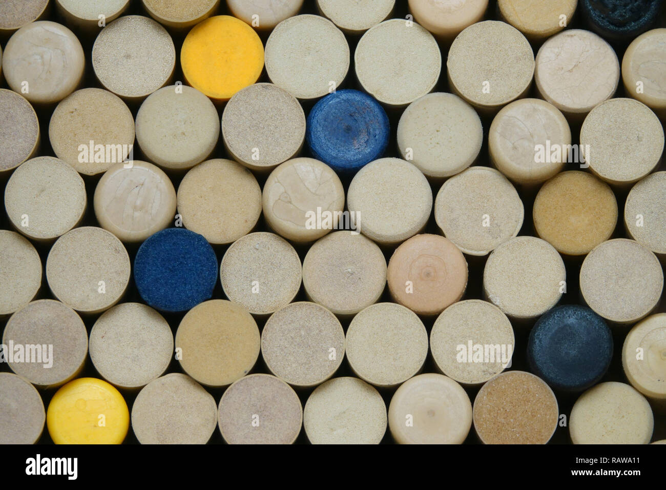 The tops of synthetic, colorful wine corks are shown loosely stacked in a closeup view. - Stock Image