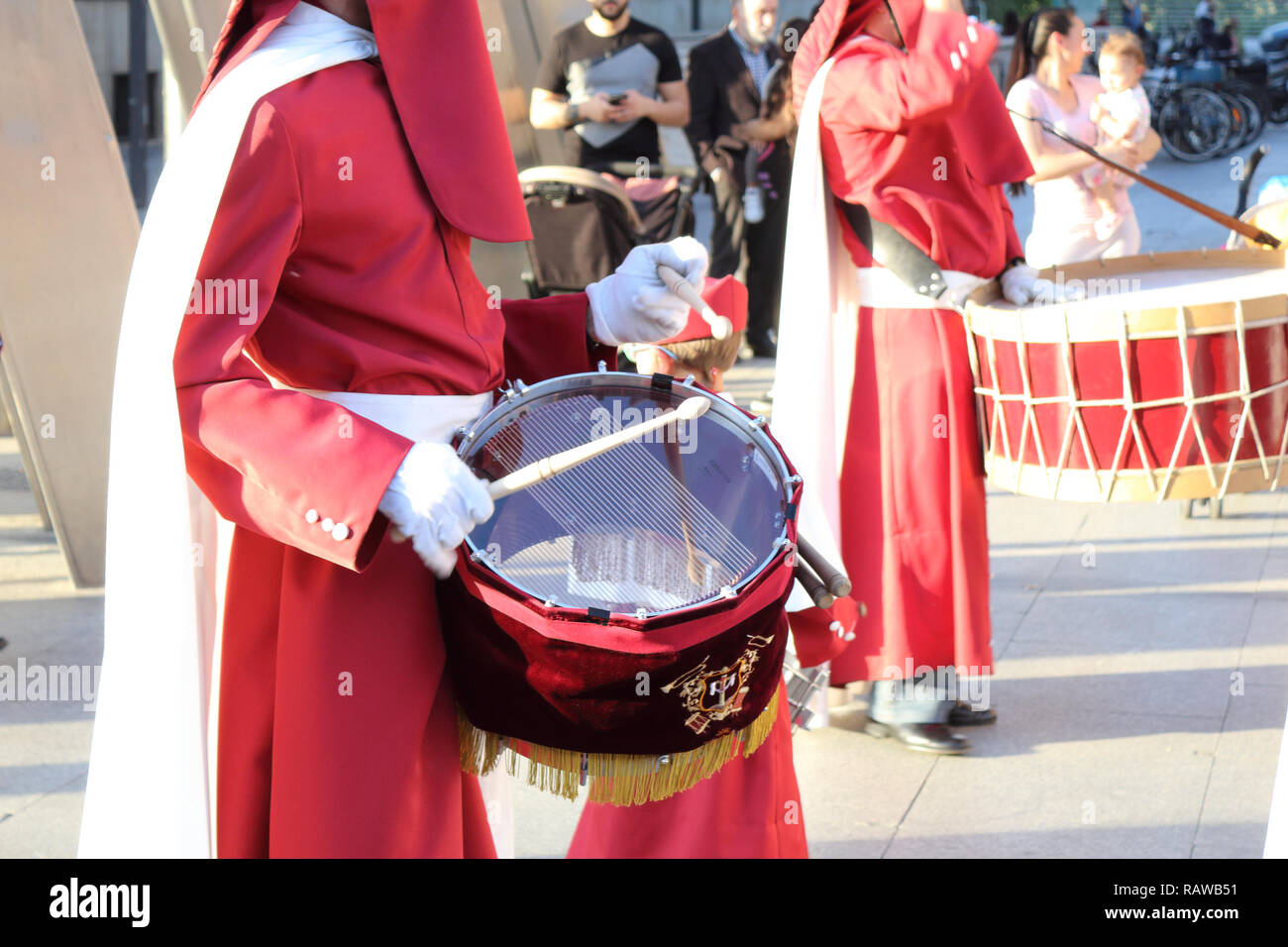 A marching band playing drums in a catholic brotherhood with