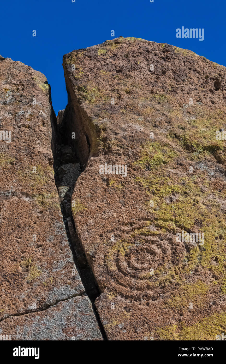 Petroglyph of concentric circlescarved into sandstone by Ancestral Puebloan People at the Tsankawi Prehistoric Sites in Bandelier National Monument ne - Stock Image