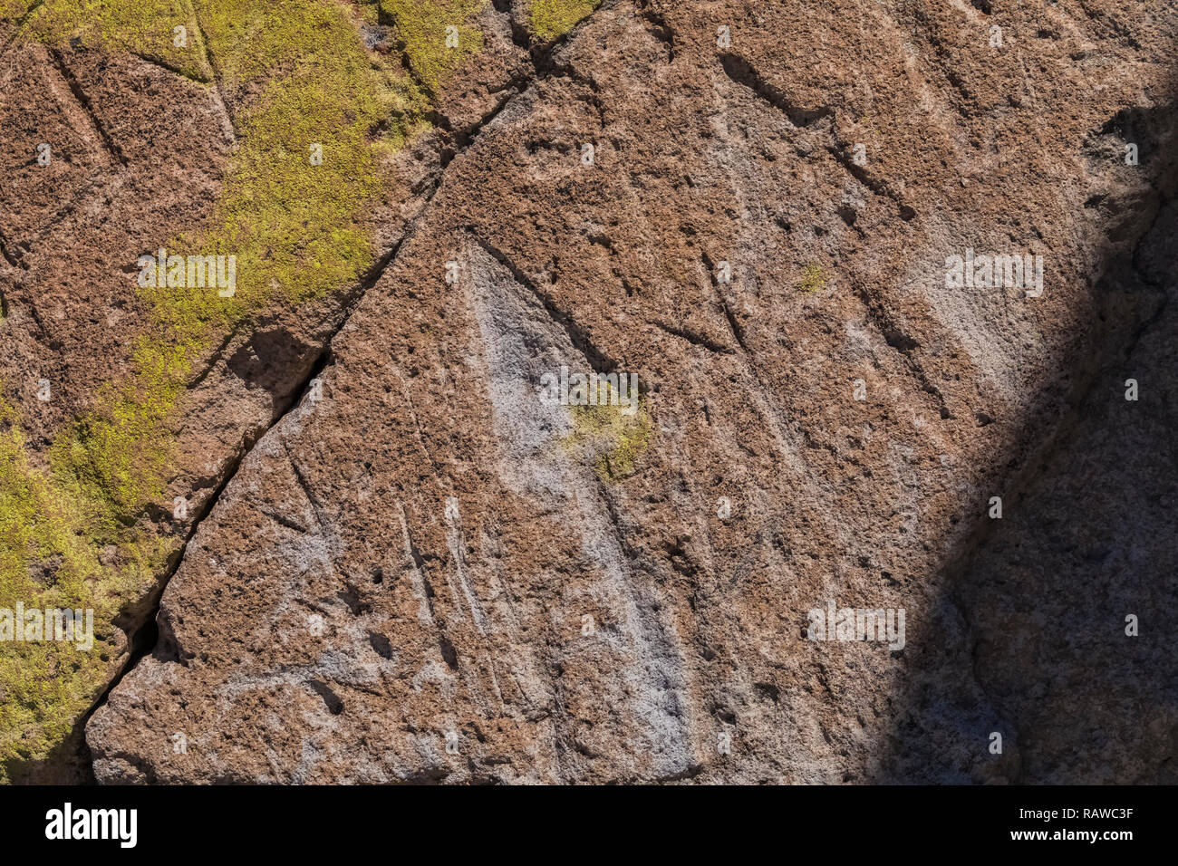 Petroglyph with arrow design carved into sandstone by Ancestral Puebloan People at the Tsankawi Prehistoric Sites in Bandelier National Monument near  Stock Photo