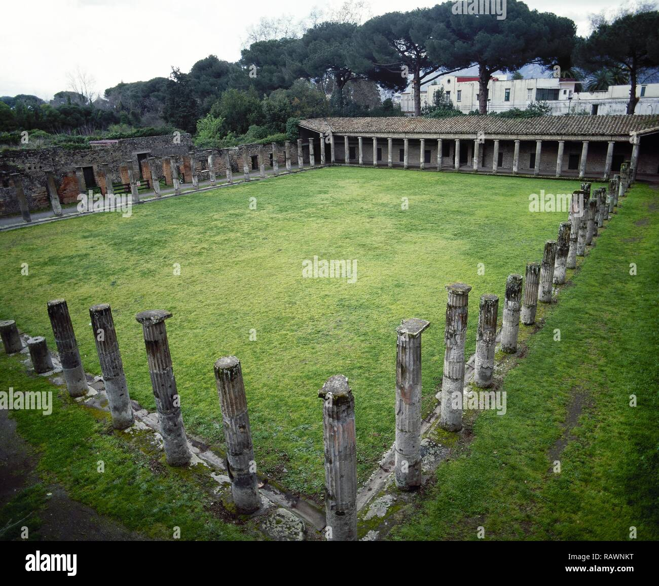 Italy. Pompeii. Quadriporticus of the theatres or Gladiators Barracks. It covers a large quadrangle surrounded by 74 Doric tuff columns used as a foyer. On this area spectators could stop during the intervals of the theatre shows. After the earthquake of 62 AD the building changed its function and became as barracks for gladiators. Theatre Area. Campania. - Stock Image