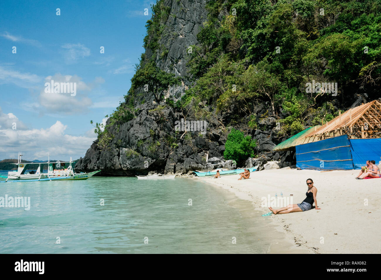 A Tourist Have A Good Time Along A Beautiful Resort Of Coron