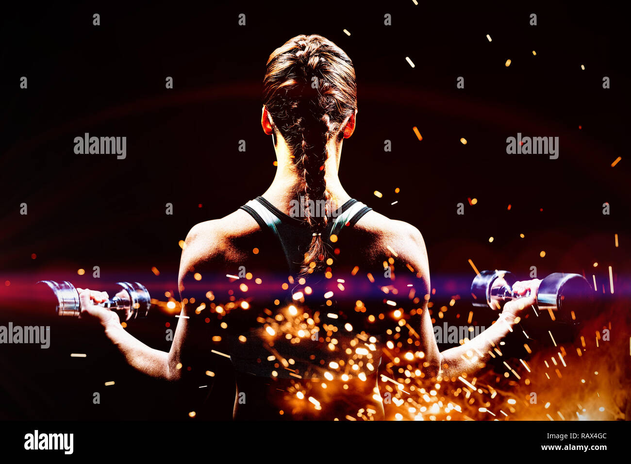 Composite image of rear view of braided hair woman lifting dumbbells - Stock Image