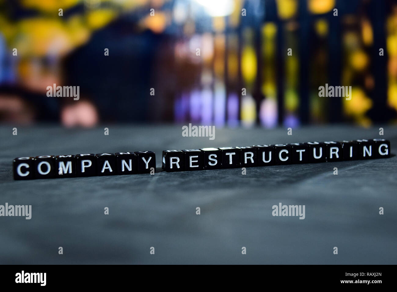 Company restructuring on wooden blocks. Business and finance concept. Cross processed image with bokeh background - Stock Image