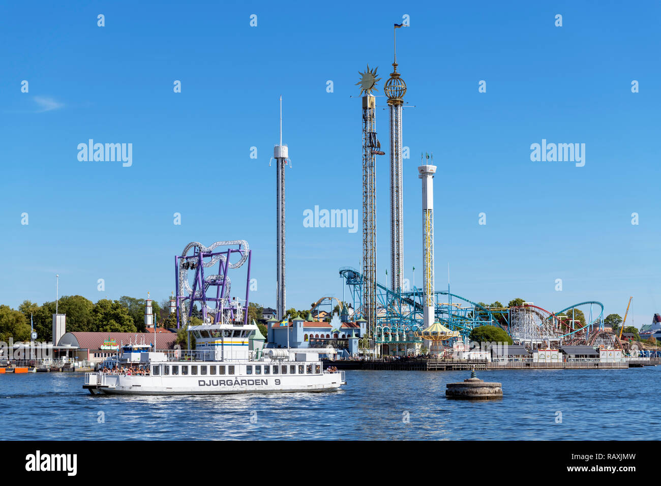 Local Skeppsholmen-Djurgården ferry in front of the Gröna Lund amusement park, Djurgården, Stockholm, Sweden - Stock Image