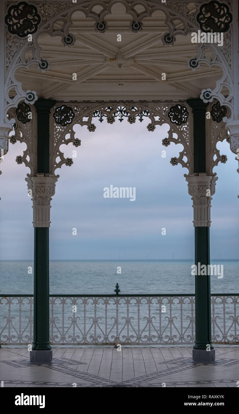 Close up of Victorian bandstand on Kings Esplanade in Brighton, East Sussex, UK. Photographed at dusk with sea behind. - Stock Image