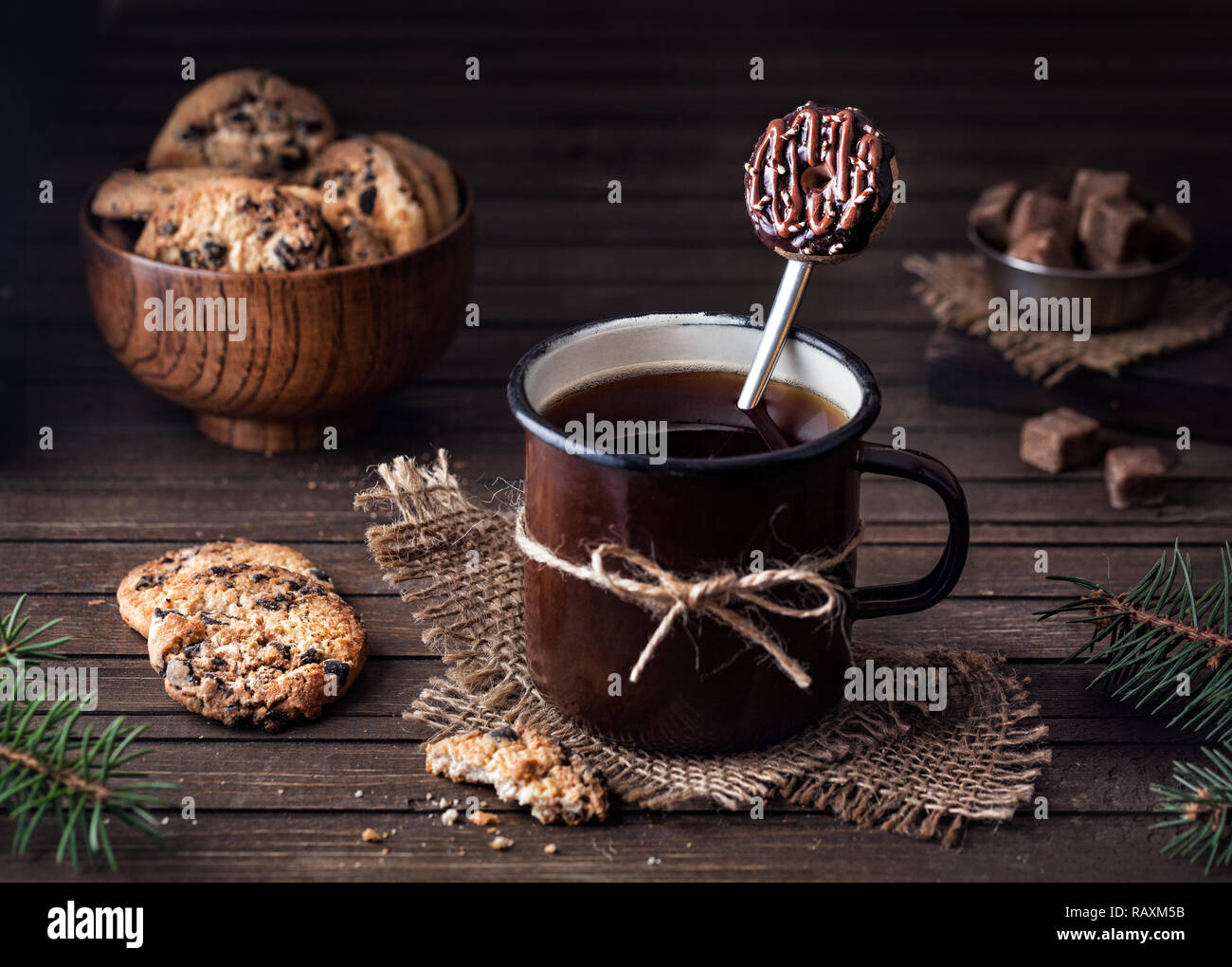 Tasty Spoon With Doughnut From Polymer Clay In The Mug With Tea Near Chocolate Cookies On Wooden Background Stock Photo Alamy