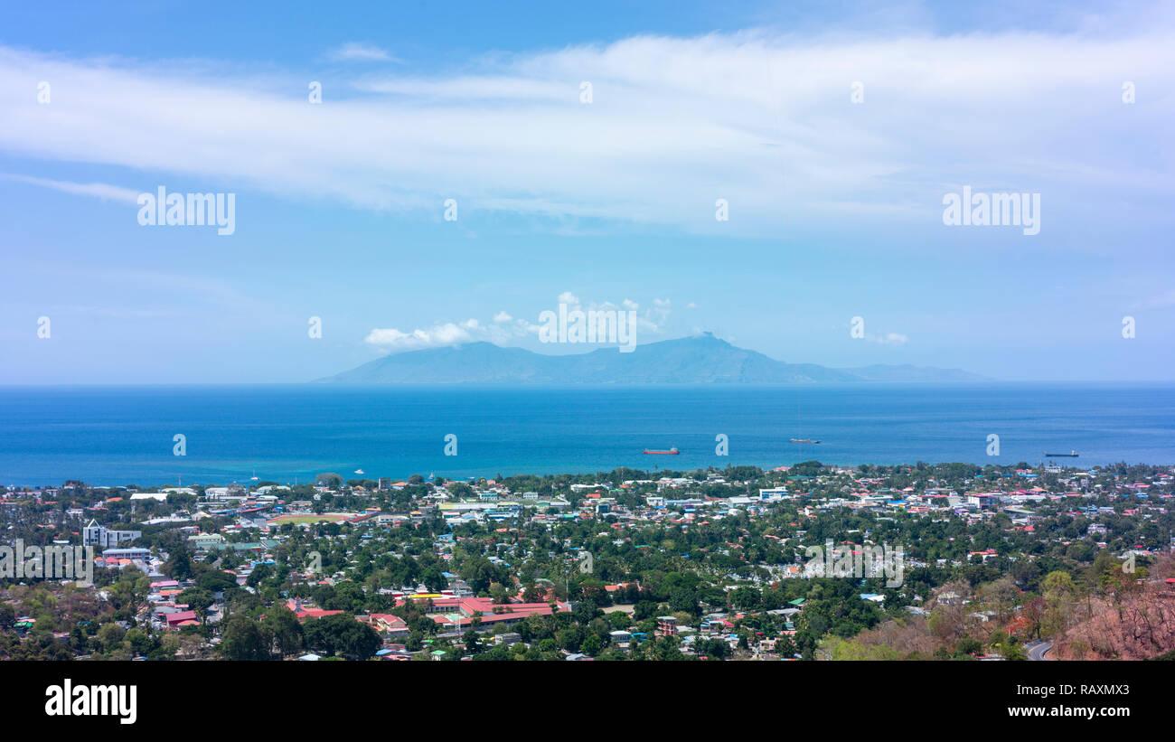 Looking across Dili and the Banda Sea toward Atauro Island. - Stock Image