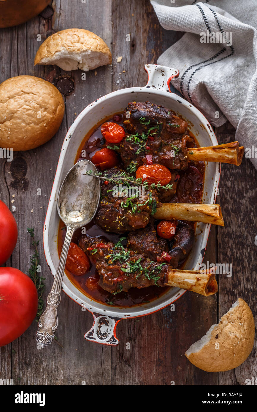 Turkish cuisine braised lamb in tomato sauce with spices and herbs. Stock Photo
