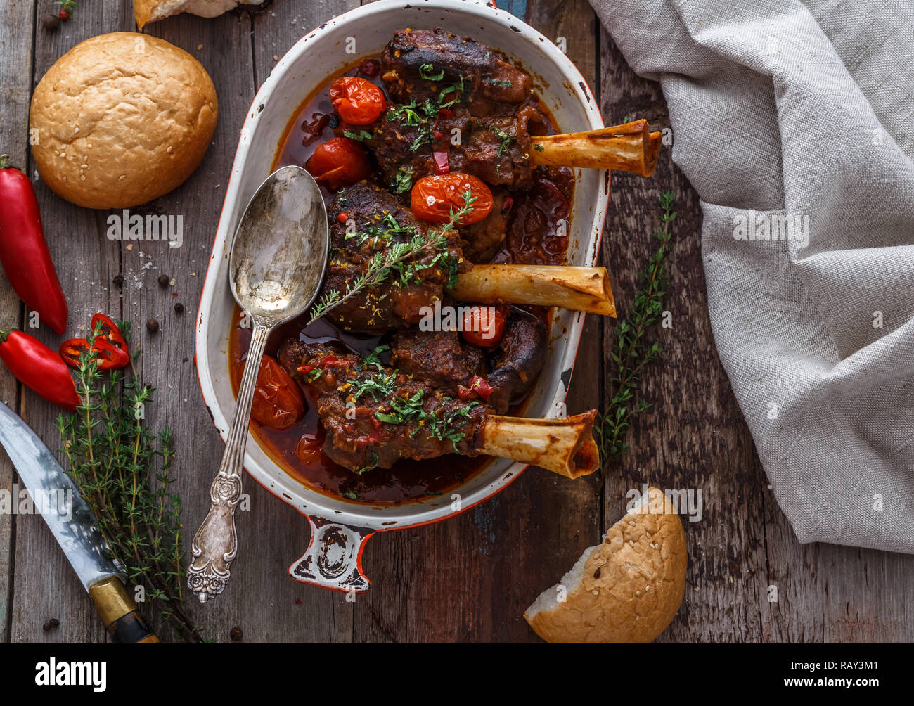 Slowly cooked lamb with tomato sauce and bread, turkish cuisine. - Stock Image