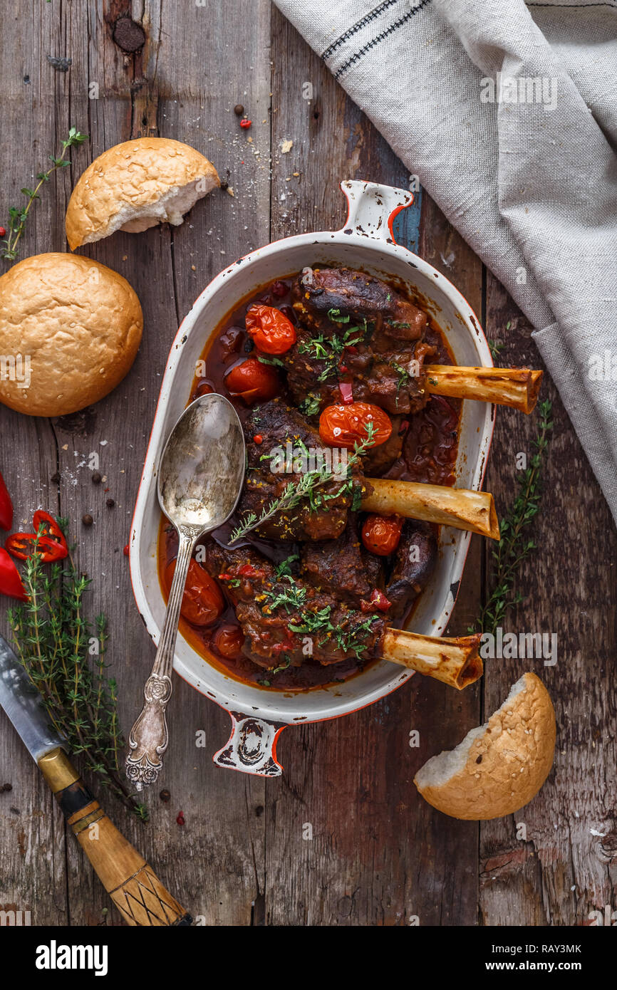 Lamb shank braised in tomato sauce, top view. Stock Photo