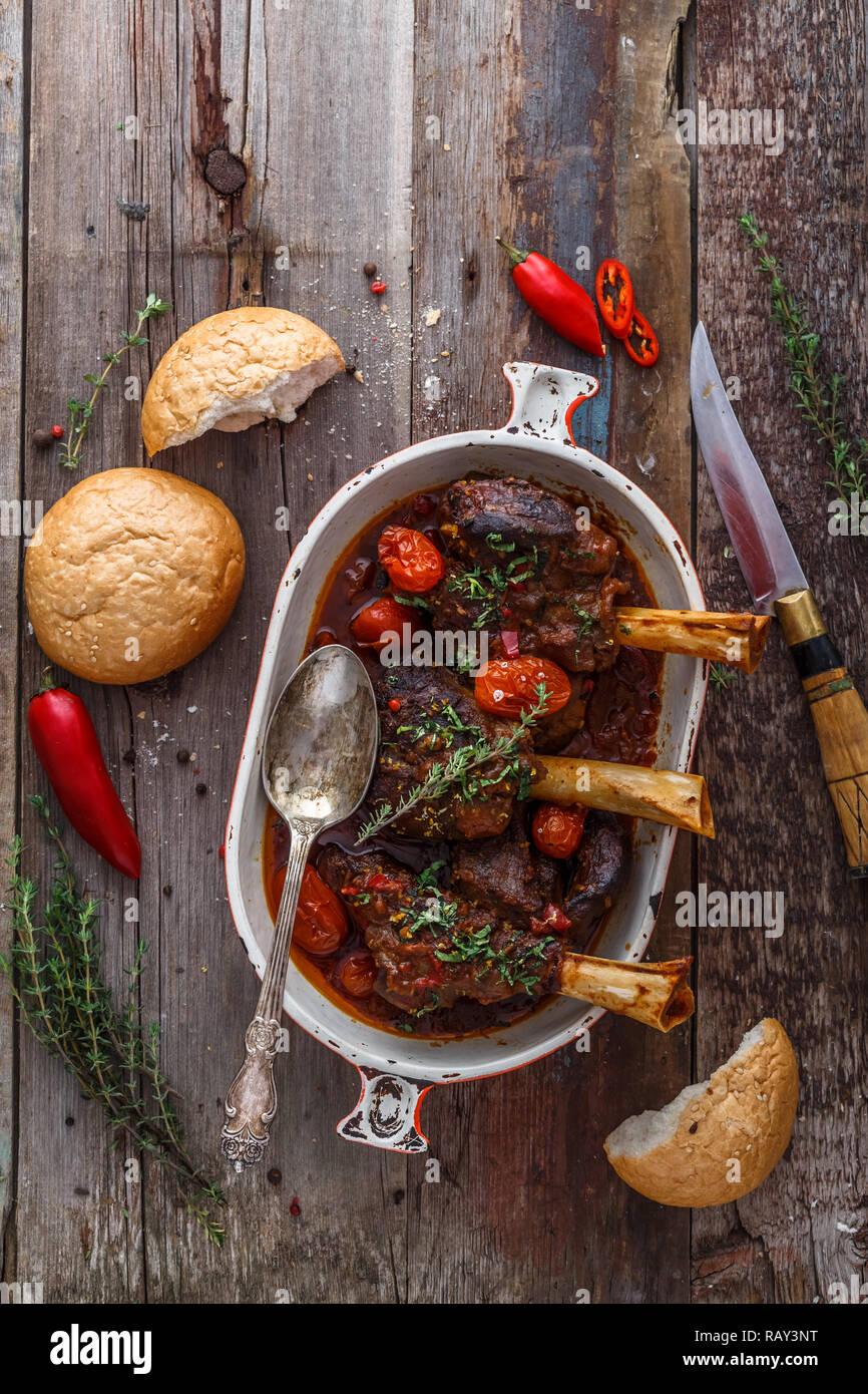 Braised lamb shanks turkish cuisine, top view rustic style. Stock Photo