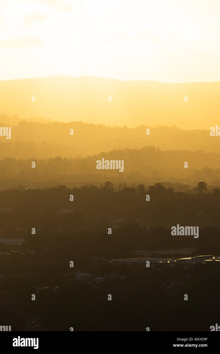 Beautiful Golden sunset over the Gold Coast Hinterland from a high rise apartment in Surfers Paradise. - Stock Image