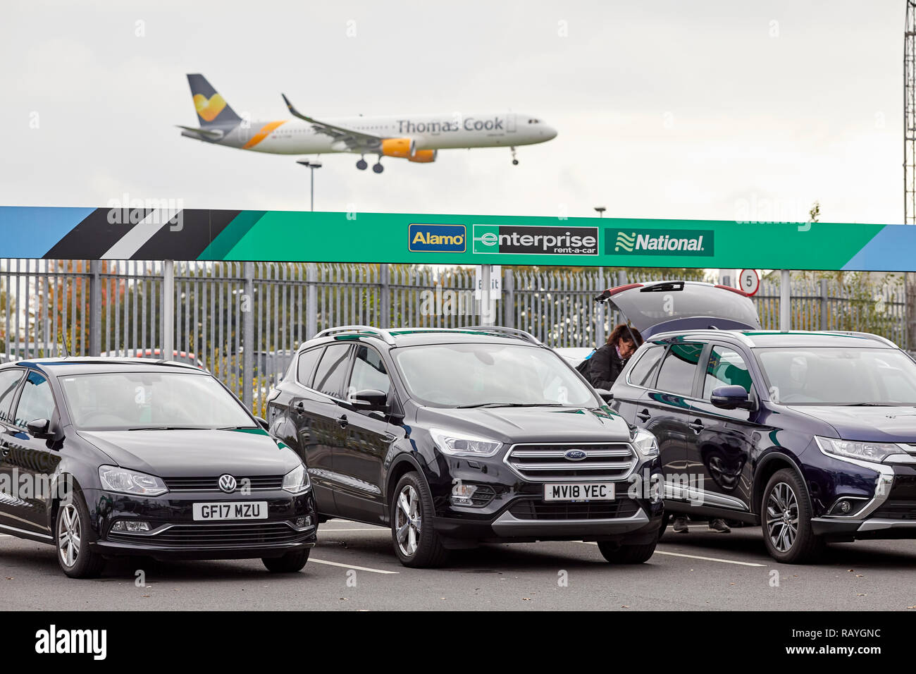 car hire company Alamo, Enterprise, National car rental village at Manchester Airport Stock Photo