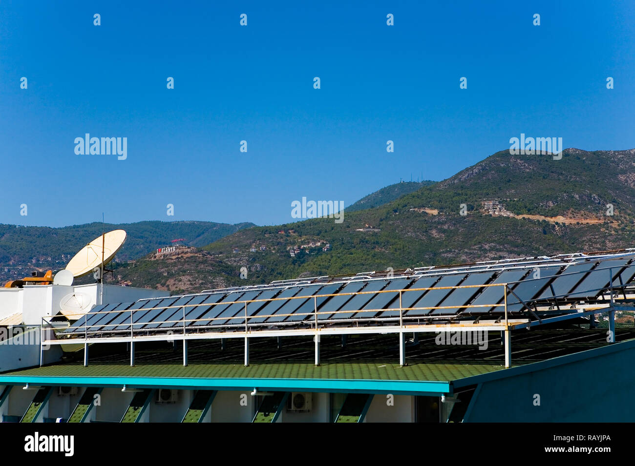 Solar panels on the roof of the building. Alanya. - Stock Image