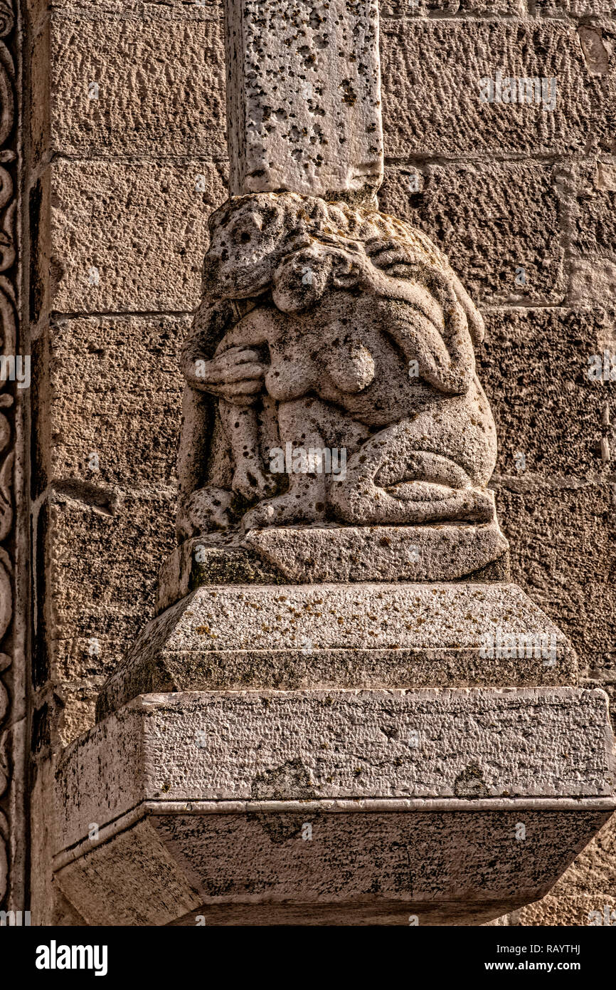 Italy Basilicat Acerenza Cathedral façade, monkeys mating with women Stock Photo