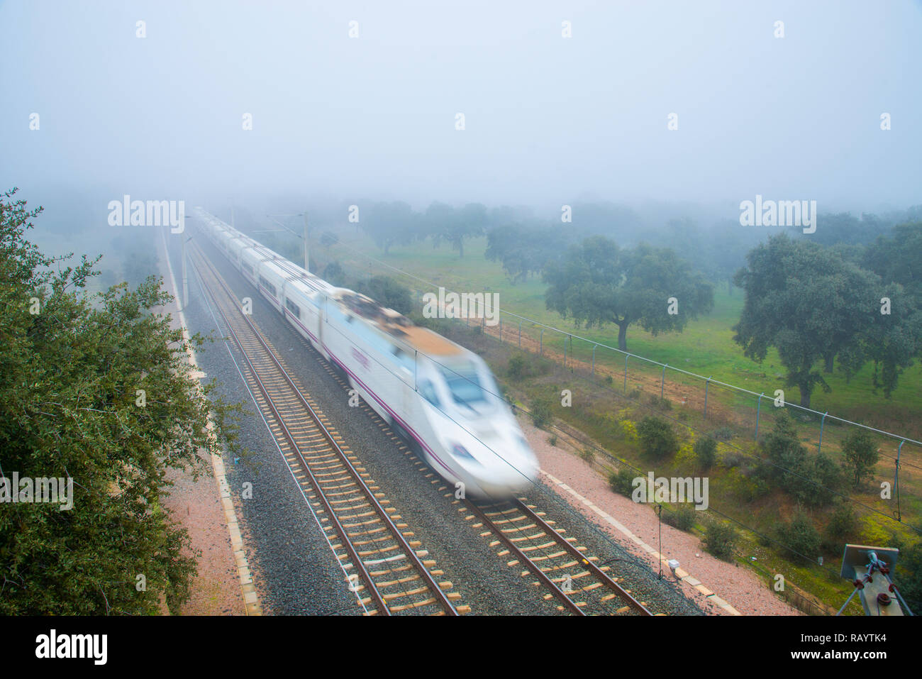 AVE high speed train traveling along Valle de Los Pedroches. Cordoba, Spain. - Stock Image