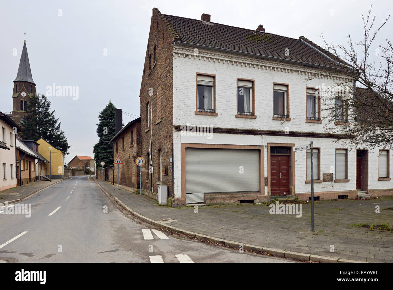 December 2018, Manheim, Kerpen-Manheim, Nordrhein-Westfalen, Germany - vacated Church St. Albertus and abandoned houses after resettlement in preparat - Stock Image