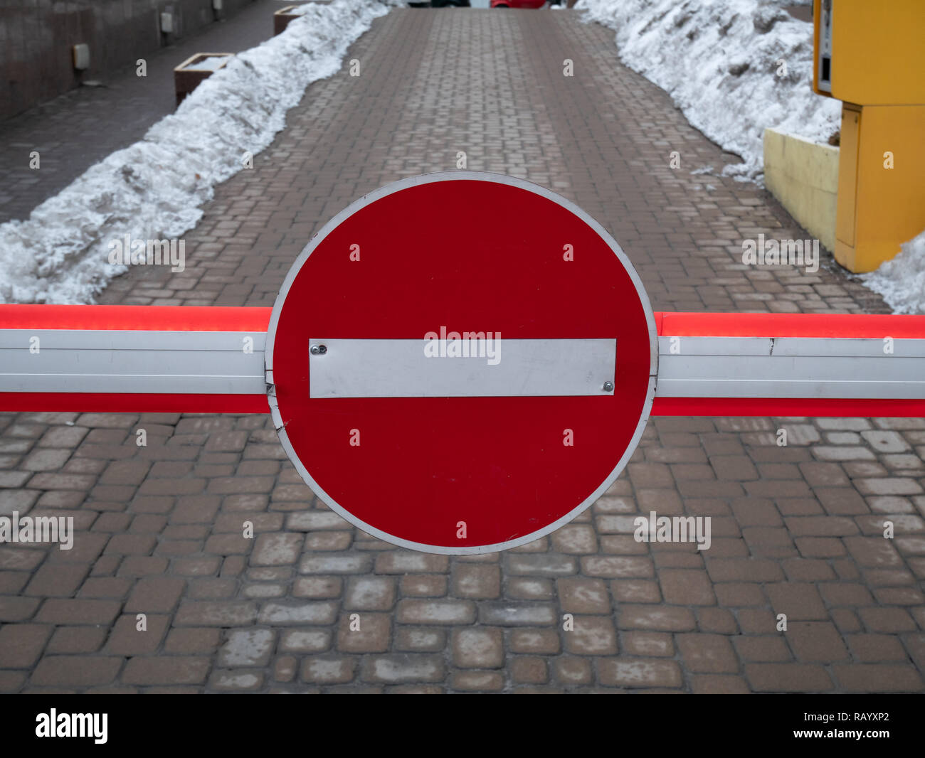 closeup of parking barrier with big red no entry sign - Stock Image