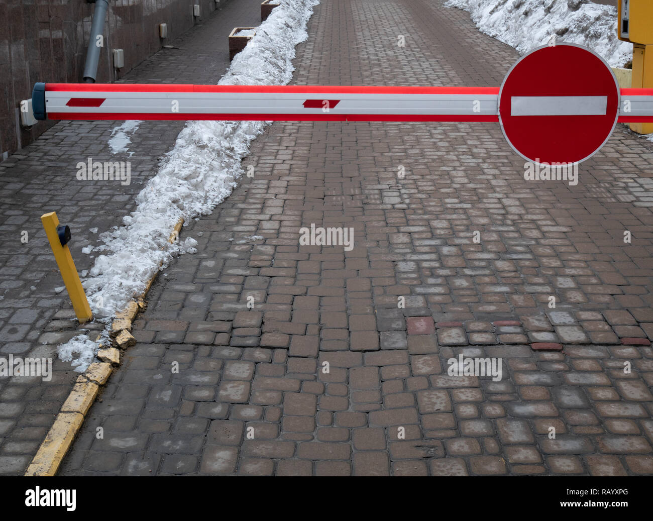 wide photo of automatic car parking gate barrier with no entry sign. private parking concept - Stock Image