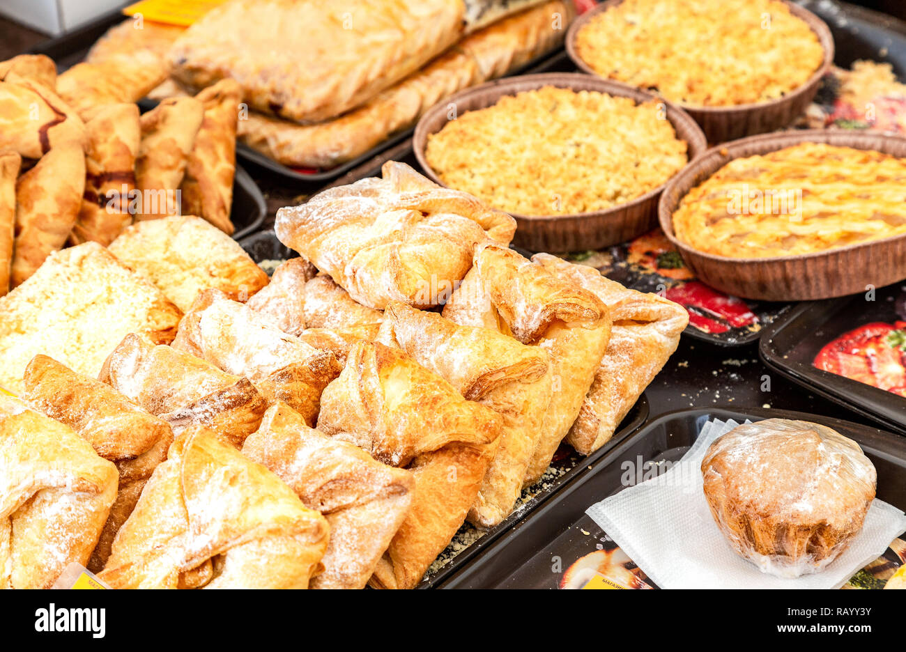 Fresh delicious sweet cakes ready for sale in local market - Stock Image