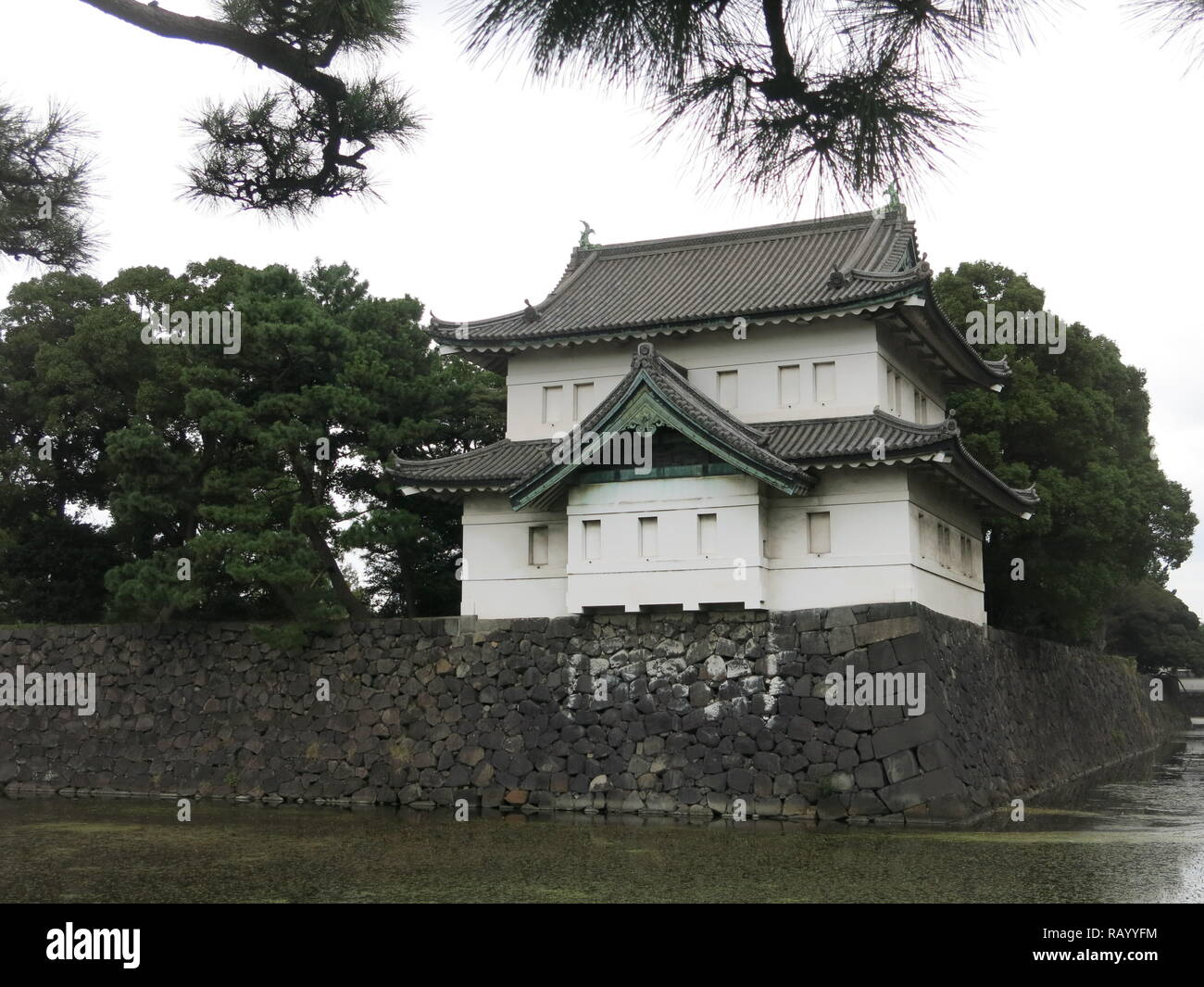 One of the guard towers atop the stone walls of the moat; Imperial Palace East Gardens, Tokyo, Japan Stock Photo