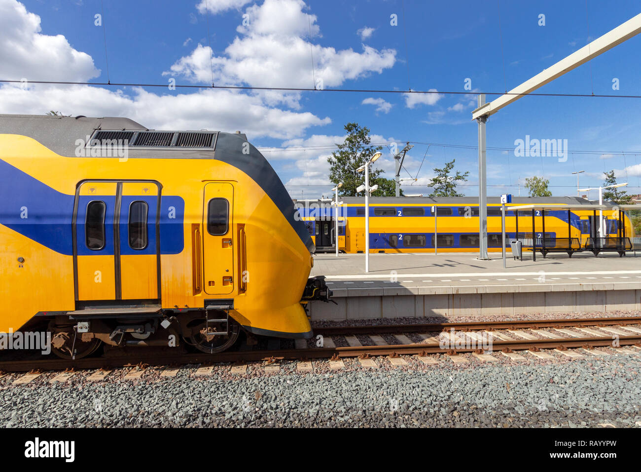 Dutch Intercity trains at the platform of a train station in The Netherlands. - Stock Image