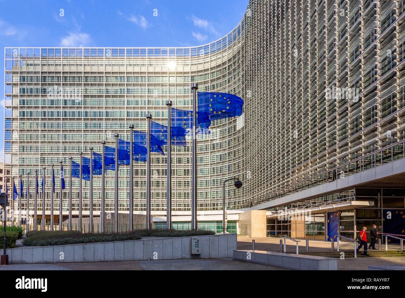 BRUSSELS, BELGIUM - JUL 30, 2014: Row of EU Flags in front of the European Union Commission building in Brussels. - Stock Image